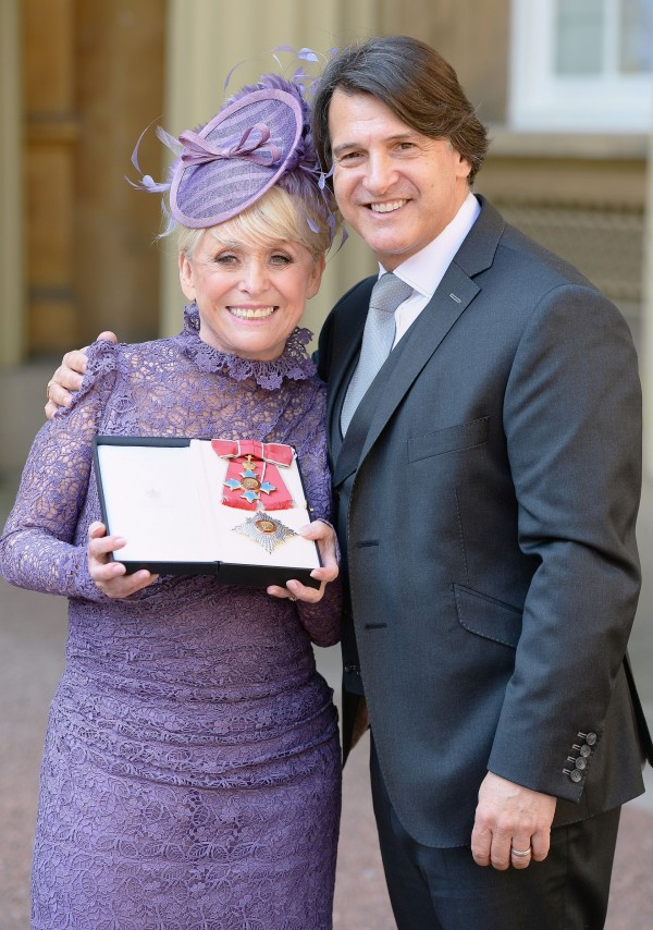 Television star Barbara Windsor with husband Scott Mitchell after she was made a Dame Commander of the order of the British Empire by Queen Elizabeth II during an Investiture ceremony at Buckingham Palace, London. (John Stillwell/PA Wire)