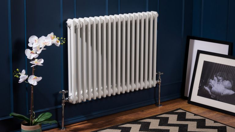 Heating your home: traditional style radiator in bathrom with atmospheric blue scheme by bathroom takeaway