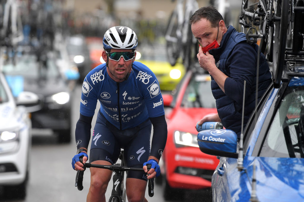 NOKERE BELGIUM MARCH 17 Mark Cavendish of United Kingdomand Team Deceuninck QuickStep Dominique Landuyt of Belgium Mechanic of Team Deceuninck QuickStep during the 75th Nokere Koerse Danilith Classic 2021 Mens Elite a 1955km race from Deinze to Nokere Mechanic Car NokereKoerse on March 17 2021 in Nokere Belgium Photo by Luc ClaessenGetty Images