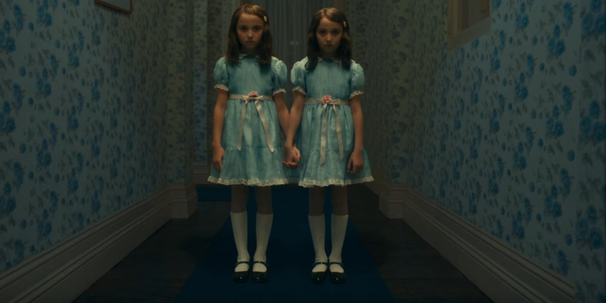 Doctor Sleep The Grady twins standing in the middle of the hallway