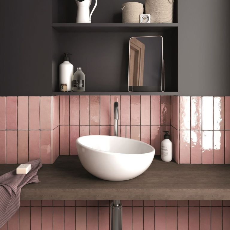 Pink tiles in a dark painted bathroom