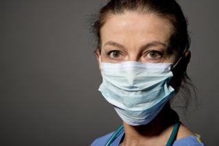A woman doctor wearing a face mask.