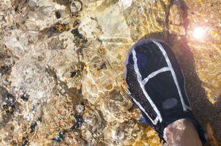 best water shoes: foot in water