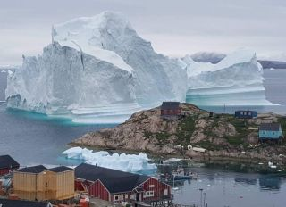 An iceberg just grounded outside the village of Innarsuit in northwestern Greenland, shown here on July 13, 2018.