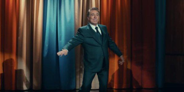 Joker Robert DeNiro hams it up in front of the late night curtain