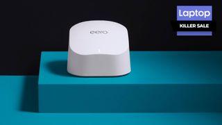White Wi-Fi router sitting on teal platform