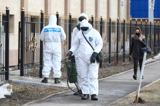 Officials in Astana, Kazakhstan carry out disinfection measures due to COVID-19 on March 30.