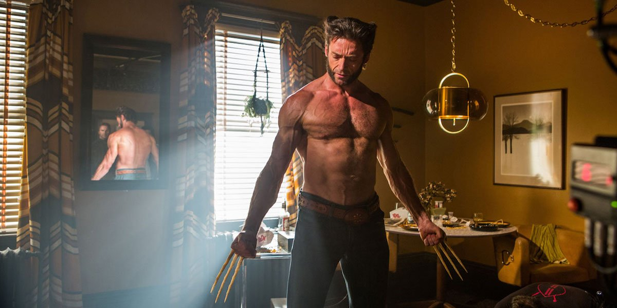 Wolverine (Hugh Jackman) stands shirtless with his claws out.