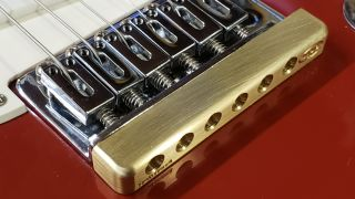 Fat Bottom machined brass tone bar fitted to an electric guitar bridge