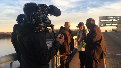 "Jeffery Robinson with civil rights activist and lawyer Faya Ora Rose Touré and Senator Henry ""Hank"" Sanders on the Edmund Pettus Bridge in Selma, Alabama."
