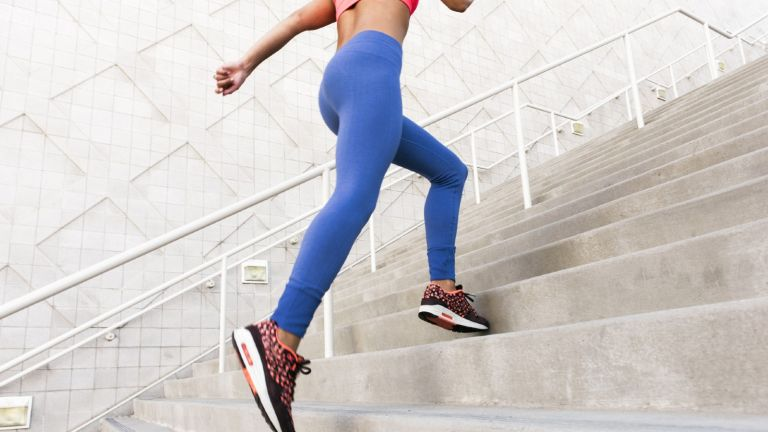 woman, wearing leggings running up stairs
