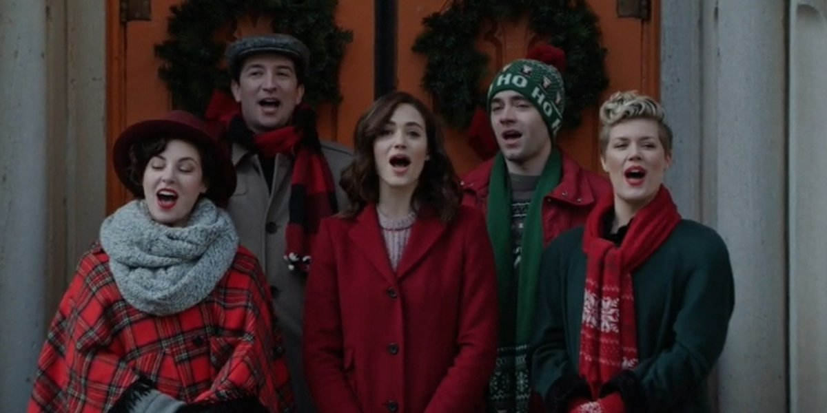 Emmy Rossum and carolers in Mr. Robot