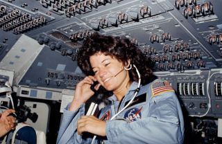 Sally Ride flew on the space shuttle Challenger in 1983, becoming the first American woman in space; after her death in 2012, her identification as LGBTQ+ became public knowledge.