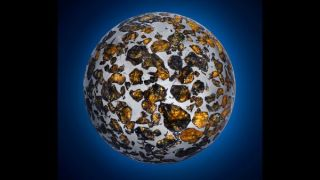 A portion of the Seymchan meteorite from Siberia was ground into a gem-studded metal sphere.