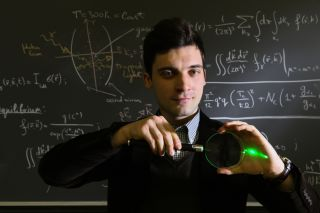 Alex Kruchkov, of the Swiss Federal Institute of Technology, demonstrates how light can be trapped inside a system, for example in a glass lens.