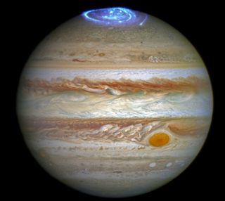 A combined image of Jupiter take by the Hubble Space Telescope in 2014 in optical light and an observations of its auroras in ultraviolet light, taken in 2016.