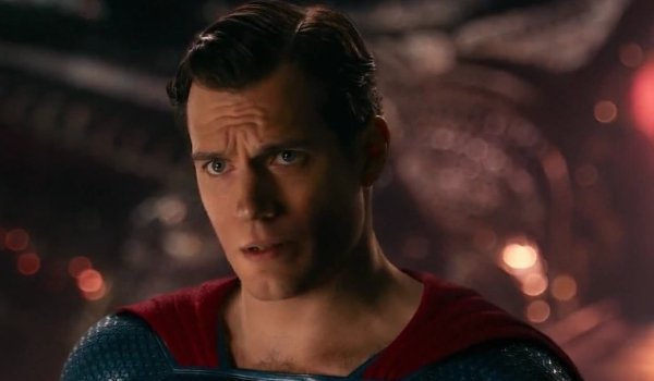 Justice League Superman explaining something in his super suit, on a command deck