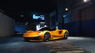 Yellow Lotus Evija parked in a warehouse
