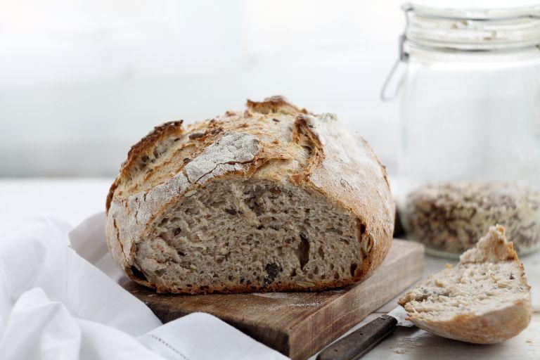Sourdough loaf cut into on chopping board
