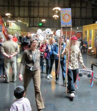 Pi Day founder Larry Shaw leads marchers — each of whom represents a digit of pi — through San Francisco's Exploratorium museum on March 14, 2012.
