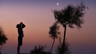 Man stargazing with binoculars
