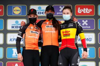 OUDENAARDE BELGIUM OCTOBER 18 Podium Amy Pieters of The Netherlands and Boels Dolmans Cycling Team Chantal Van Den Broek Blaak of The Netherlands and Boels Dolmans Cycling Team Lotte Kopecky of Belgium and Team Lotto Soudal Ladies Celebration Mask Covid safety measures during the 17th Tour of Flanders 2020 Ronde van Vlaanderen Women Elite a 1356km stage from Oudenaarde to Oudenaarde RVV20 FlandersClassic on October 18 2020 in Oudenaarde Belgium Photo by Bas CzerwinskiGetty Images