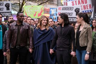 Supergirl (Melissa Benoist) and the rest of the heroes of National City march to defend alien rights.