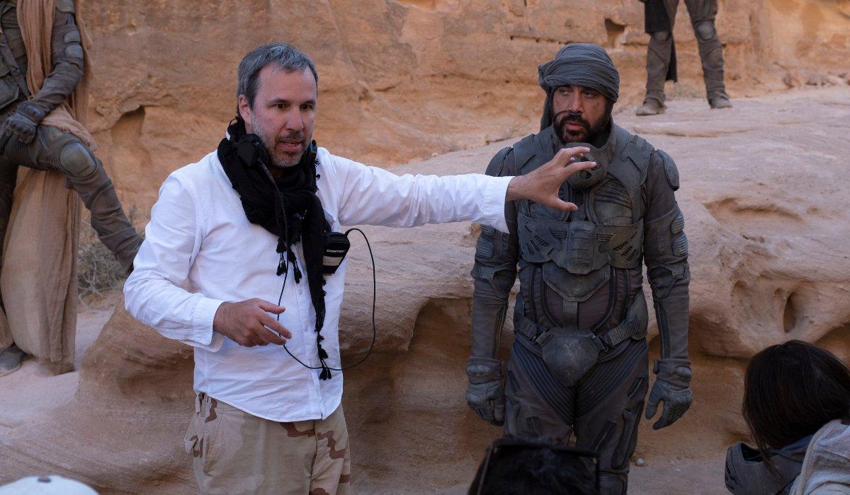 Dune Denis Villeneuve directs on set while Javier Bardem watches