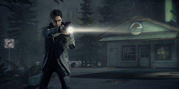 Alan Wake aims flashlight and gun