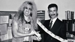 Dee Snider and Frank Zappa hold up parental advisory stickers during the PMRC senate hearing at Capitol Hill, Washington DC, United States, 19th September 1985