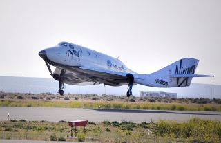 SpaceShipTwo makes a May 4, 2011 landing on Runway 30 at the Mojave Air and Space Port in California. Touch down signaled the successful end to the craft's 7th glide test and, for the first time, evaluation of its novel feather re-entry system.