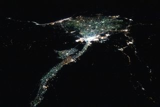 City lights around the Nile River and its delta sparkle by night in this stunning view from the International Space Station. When an Expedition 60 astronaut captured this photo, the International Space Station was flying 255 miles (410 kilometers) above the border between Sudan and Egypt around 1 a.m. local time on Sept. 2.
