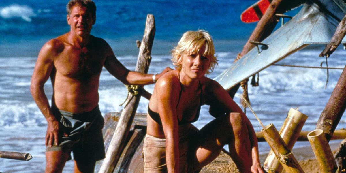 Six Days Seven Nights Harrison Ford and Anne Heche stand amid their beach camp