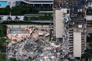 This aerial view of the partially collapsed Champlain Towers South, north of Miami Beach, shows search-and-rescue personnel at the site.