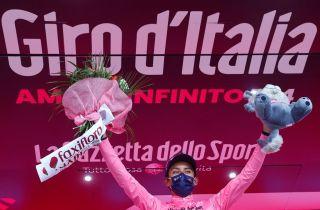 Egan Bernal celebrates on the podium with one day to go to finishing the Giro d'Italia