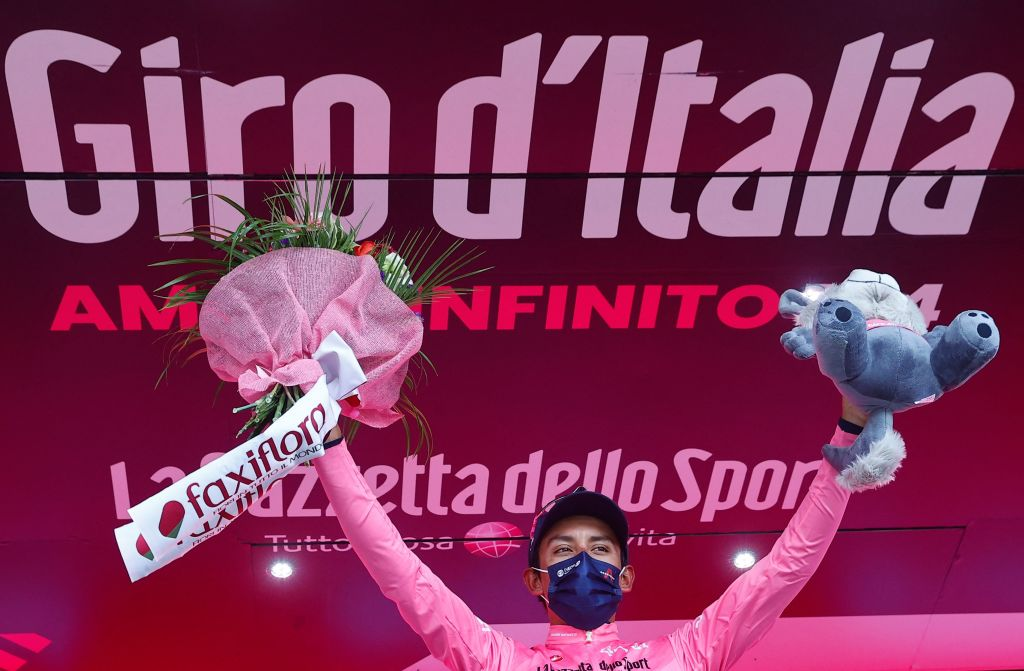 Overall leader Team Ineos rider Colombias Egan Bernal celebrates on the podium after the 20th stage of the Giro dItalia 2021 cycling race 164km between Verbania and Valle Spluga Alpe Motta Madesimo on May 29 2021 Photo by Luca Bettini AFP Photo by LUCA BETTINIAFP via Getty Images