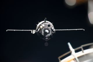 The Soyuz MS-13 crew spacecraft is seen approaching the International Space Station on July 20, 2019. It will return to Earth on Feb. 6, 2020.