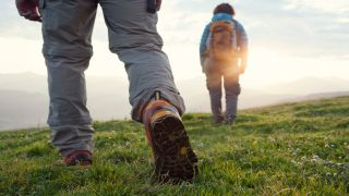 Hikers crossing a field