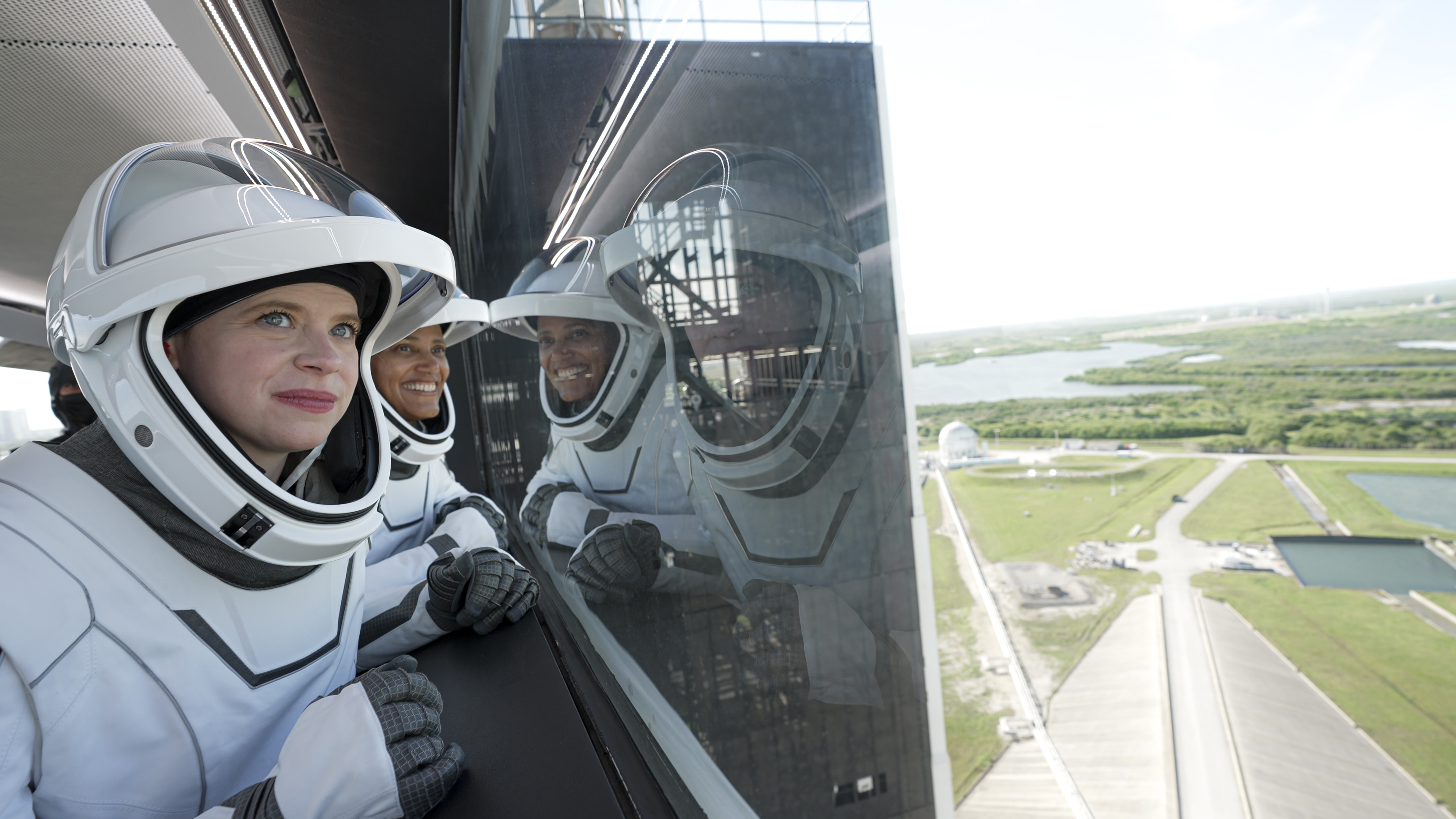 SpaceX Inspiration4 crewmembers Hayley Arceneaux (foreground) and Sian Proctor take in the view from the Crew Access Arm leading to their Crew Dragon Resilience ahead of launching from NASA's Pad 39A at the Kennedy Space Center in Florida on Sept. 15, 2021.
