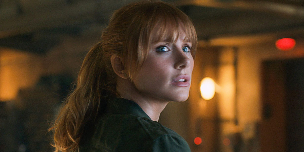 Bryce Dallas Howard looking at a dinosaur in Jurassic World