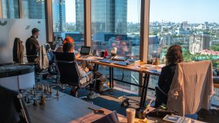 colleagues working in office with a view of a city skyline