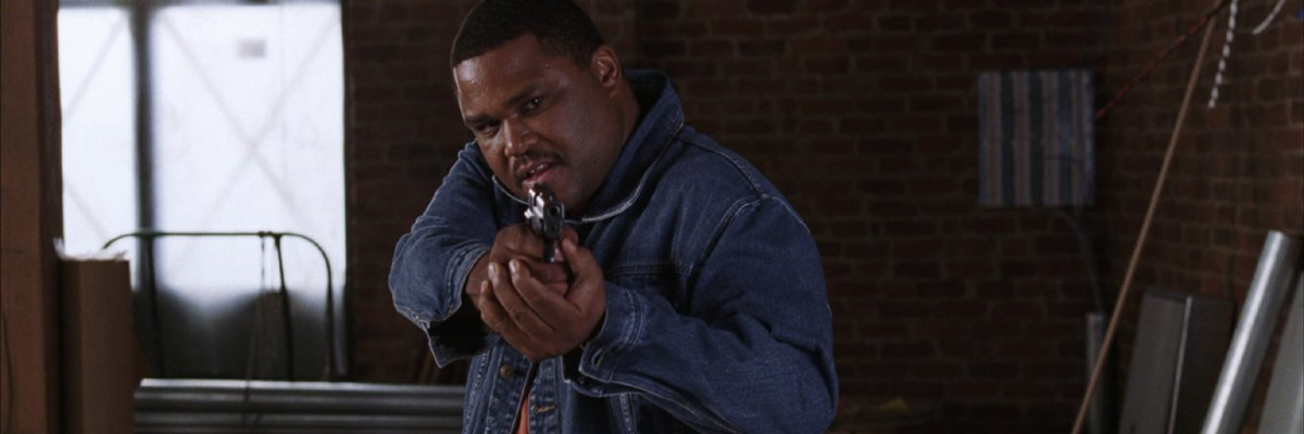 Anthony Anderson with Xs in The Departed