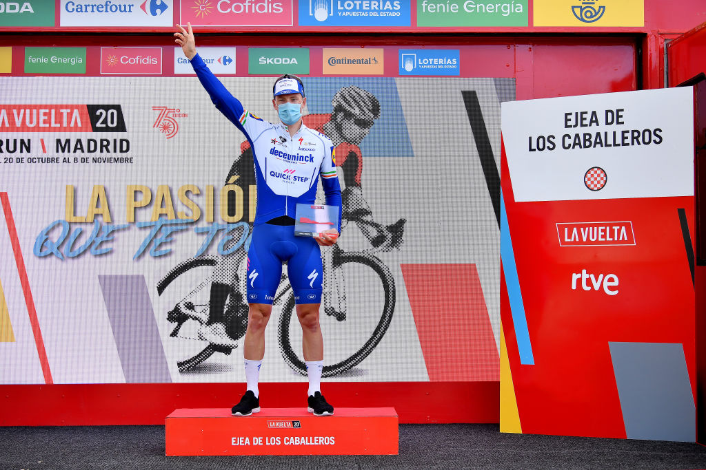 EJEADELOSCABALLEROS SPAIN OCTOBER 23 Podium Sam Bennett of Ireland and Team Deceuninck QuickStep Celebration Trophy Mask Covid safety measures during the 75th Tour of Spain 2020 Stage 4 a 1917km stage from Garray Numancia to Ejea de los Caballeros lavuelta LaVuelta20 La Vuelta on October 23 2020 in Ejea de los Caballeros Spain Photo by Justin SetterfieldGetty Images