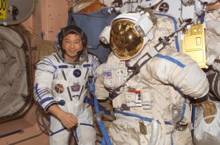 Astronaut Leroy Chiao and sokol suit