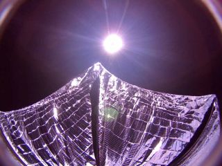 The Planetary Society's LightSail cubesat captured this image of its deployed solar sails in Earth orbit on June 8, 2015.