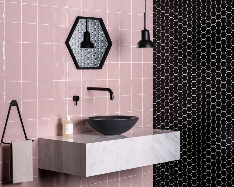 Black and pink tiled bathroom with black sink by Original Style