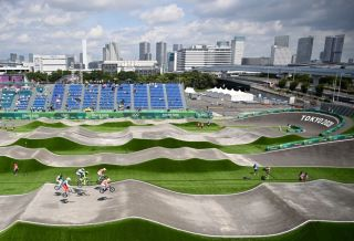TOPSHOT Cyclists compete in the cycling BMX racing mens quarterfinals run at the Ariake Urban Sports Park during the Tokyo 2020 Olympic Games in Tokyo on July 29 2021 Photo by Lionel BONAVENTURE AFP Photo by LIONEL BONAVENTUREAFP via Getty Images