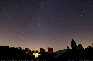 Several Perseid meteors dash across the sky above Italy's Castel Santa Maria in this photo by astrophysicist Gianluca Masi of the Virtual Telescope Project taken during the peak on Aug. 12-13, 2018.