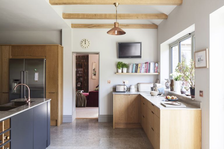 Planning for kitchen extension costs: this kitchen has exposed beams and oak units