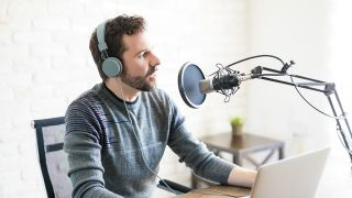Man speaking into a podcast mic